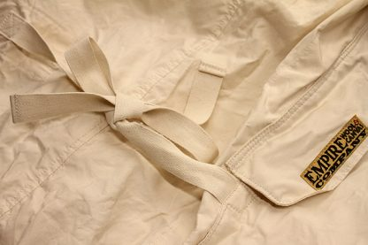 Traditional Arctic Anorak pocket flap and cotton tape ties.